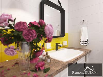 Ванна кімната з жовтими елементами